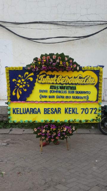 bunga papan duka cita